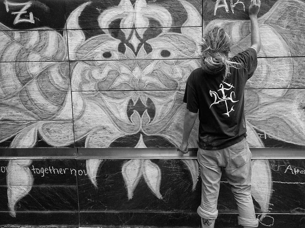 artist places design on slate