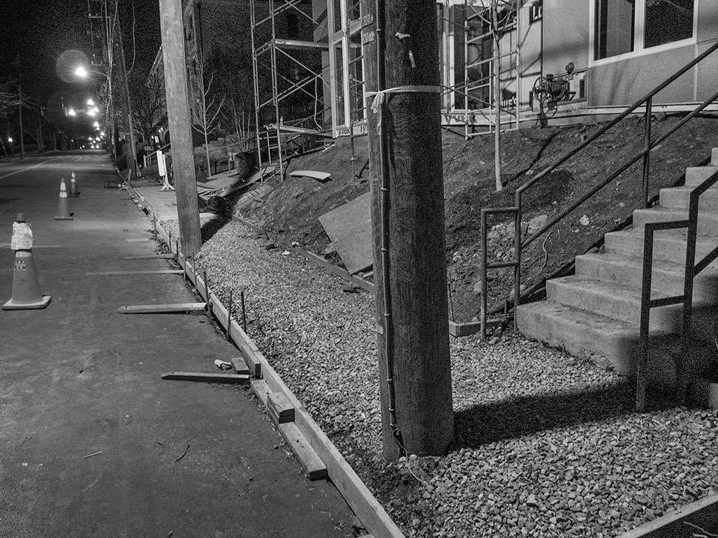 utility poles in sidewalk