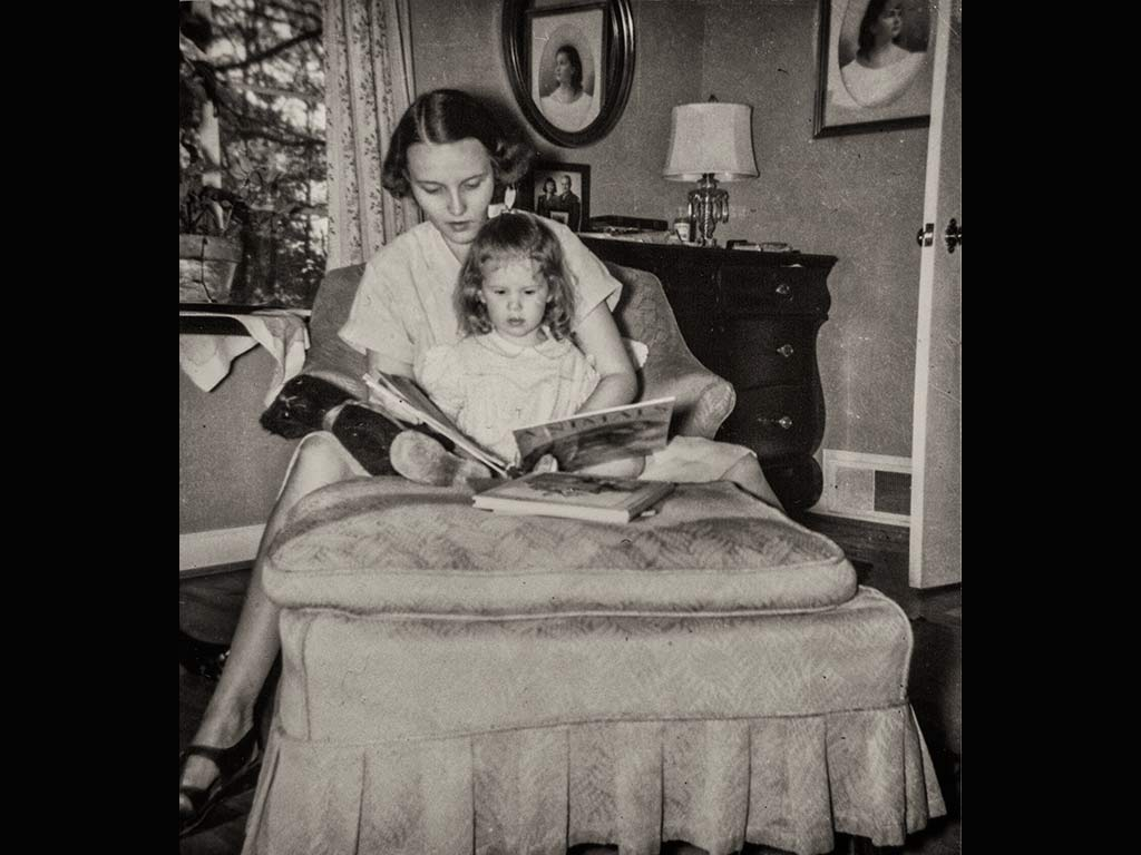 mother reading animals to her daughter