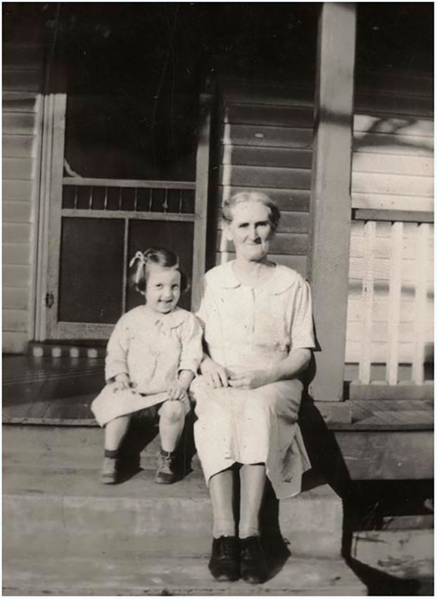 Betty Lou on the porch of her natal home with grandmother Ethel Leake Scruggs