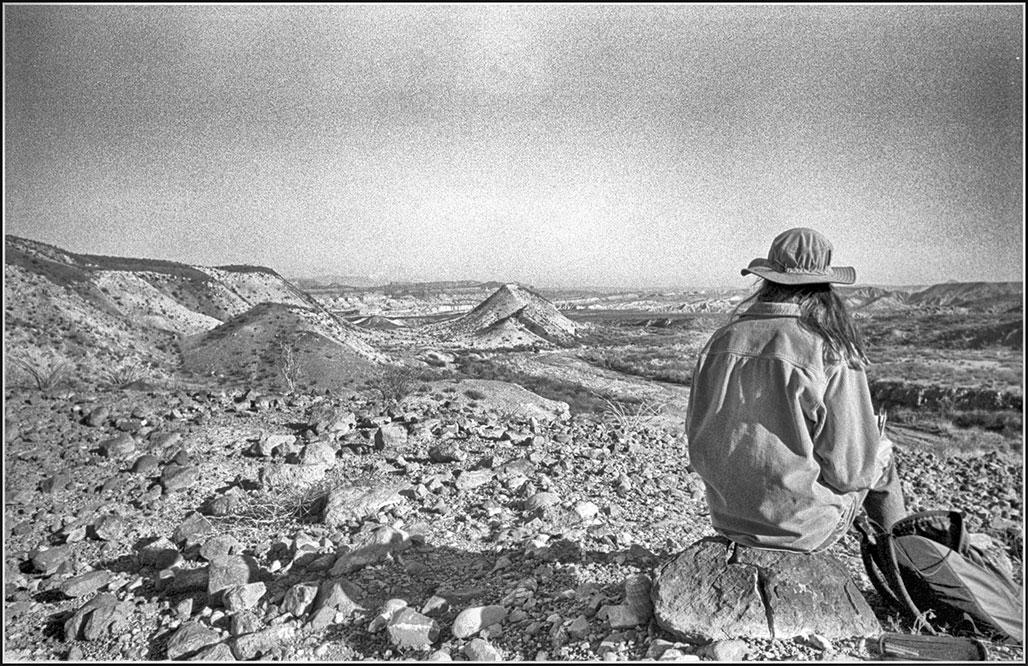 girl in hat in desert